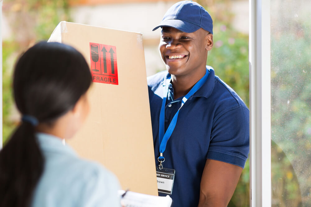 Postman delivering box - how to file a workers compensation claim blog post